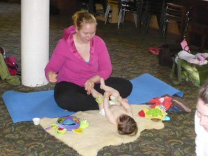 Massage can make babies playful...