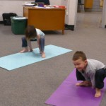 "Little Yogis ""spider pose"""