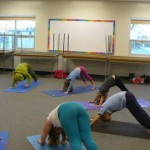 Power Yogis, triangle (dog pose) in Sun Salutation